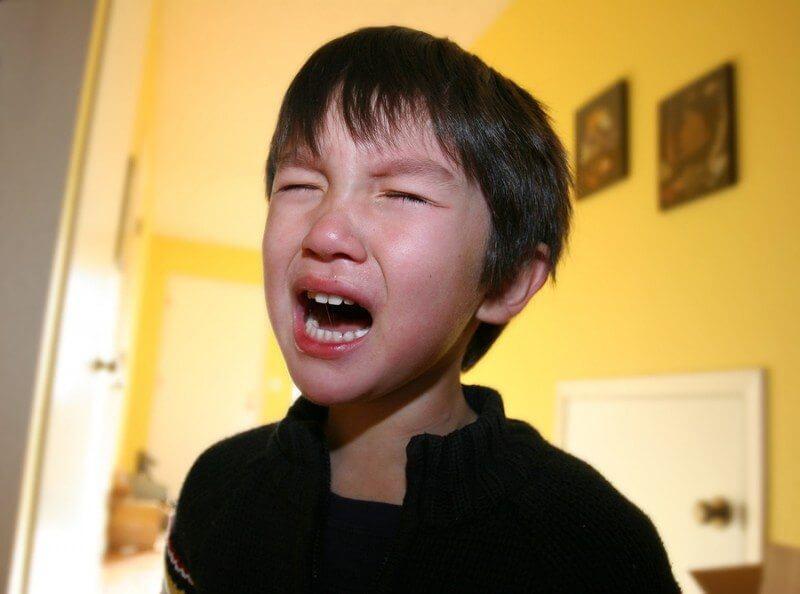 Three years old boy having autistic meltdown